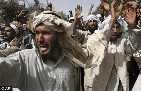 Afghan men shout anti American slogans during a protest over the deaths of two men in Ghazni, west of Kabul, Afghanistan, today.
