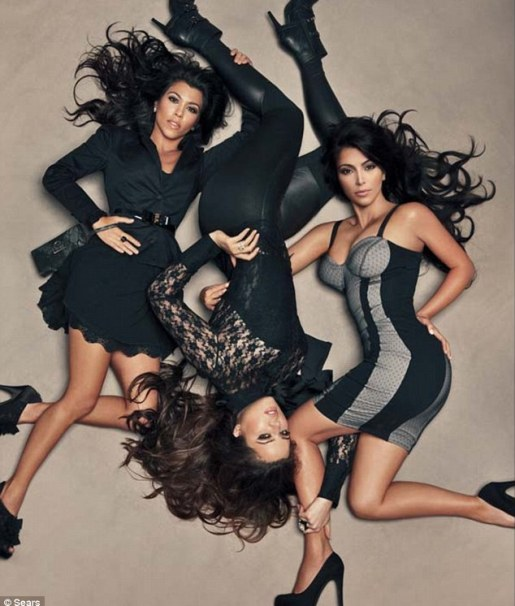 Celebrity style: The new Kardashian Kollection for Sears bears all the signatures of Kim, Kourtney and Khloe - figure-hugging dresses, printed pantsuits and of course, sky-high platform shoes