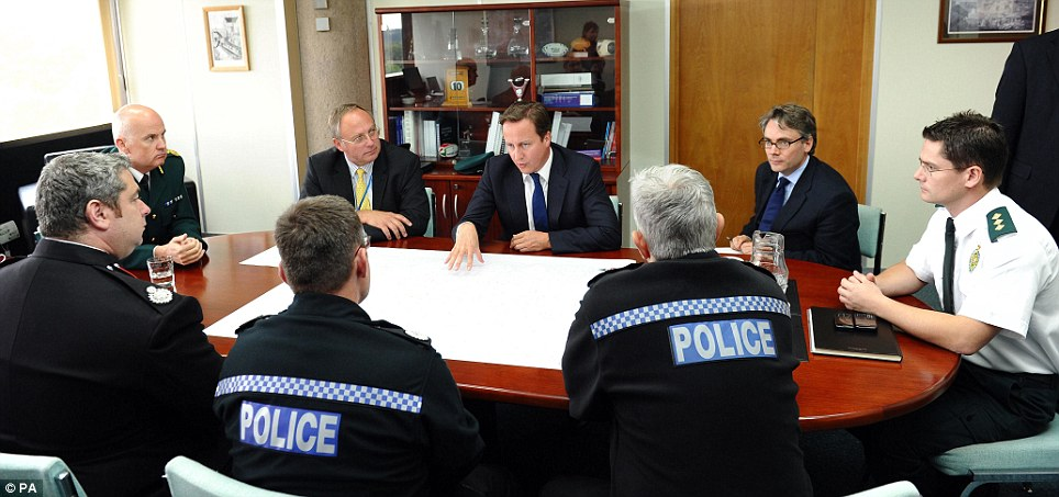 Meeting: The Prime Minister discusses tactics with senior officers from the police, fire and ambulance services at the Wolverhampton Civic Centre