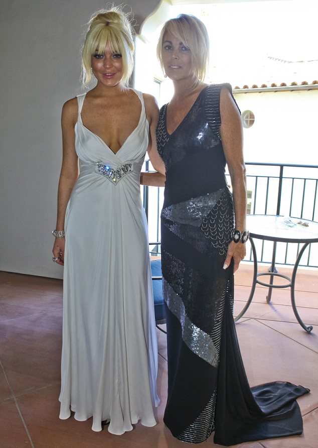 Two generations: Lindsay Lohan, left, and her mother glitter in their takes on the monochrome dress theme. Li-Lo wore the same dress as Pippa Middleton did to the Royal wedding reception