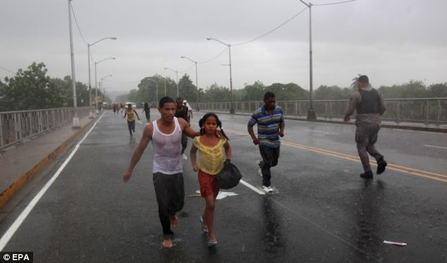 Drenched: Hurricane Irene has continued to strengthen as it has raged over the Caribbean