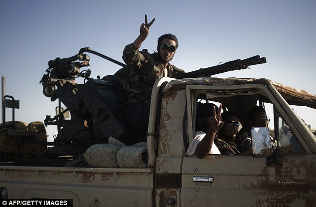 Onward: The Libyan rebels are now marching on to Sirte, where they believe Gaddafi is hiding - despite claims from Robert Mugabe that he is in Zimbabwe
