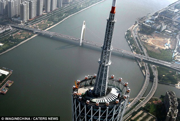 This is the world's 'highest' Ferris wheel on top of a 1,480ft tower in China - with passengers riding in see-through pods