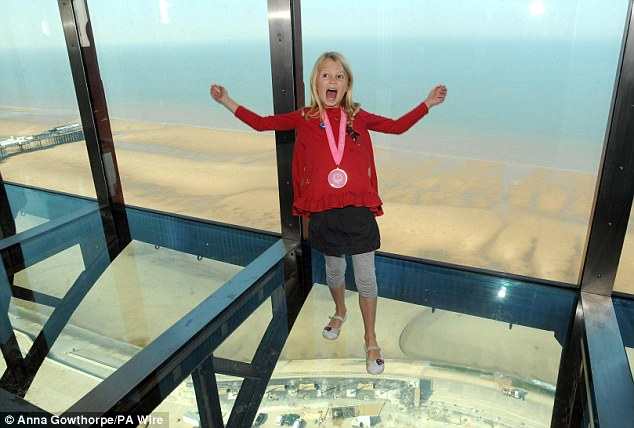 Not afraid: Reassuring the faint-hearted - the glass floor weighs half a tonne and is made up of two sheets of solid laminated glass.