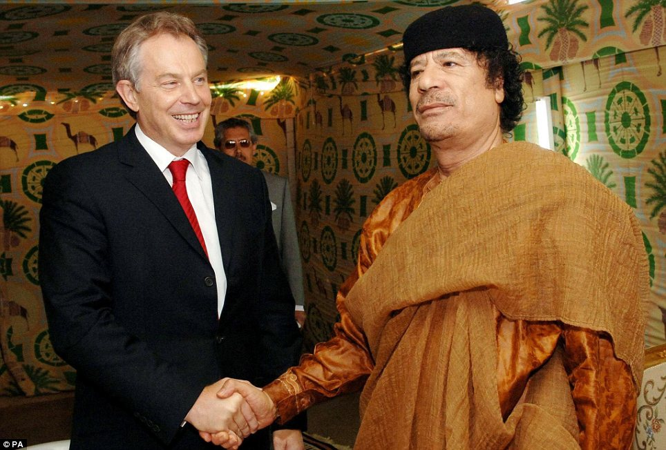 Friends: Former Prime MinisterTony Blair greets Muammar Gaddafi at his desert base outside Tripoli in 2007