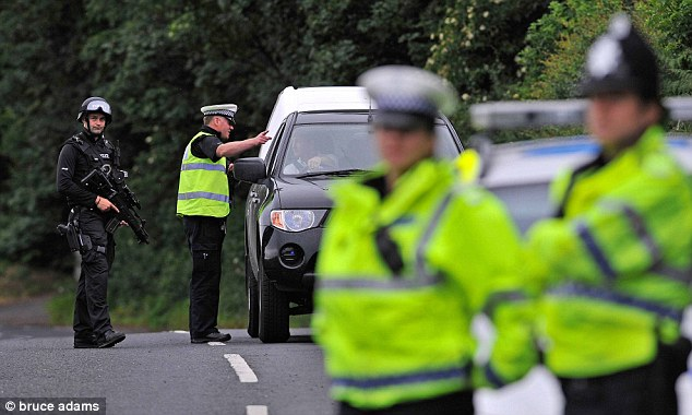 Armed police stopped hundreds of motorists when they stood guard on the edge of Rothbury during the search for Moat