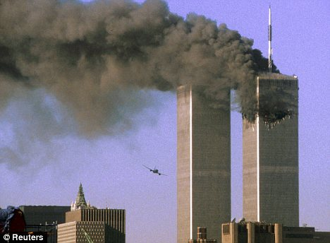 Chaos: Rick Rescorla, who was head of security for banking firm Morgan Stanley Dean Witter, is credited with saving 2,700 people by making sure they left the World Trade Centre's South Tower before it collapsed