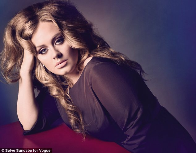 Happy as she is: Adele who graces the cover of UK Vogue for the October issue has spoken out about her fuller figure