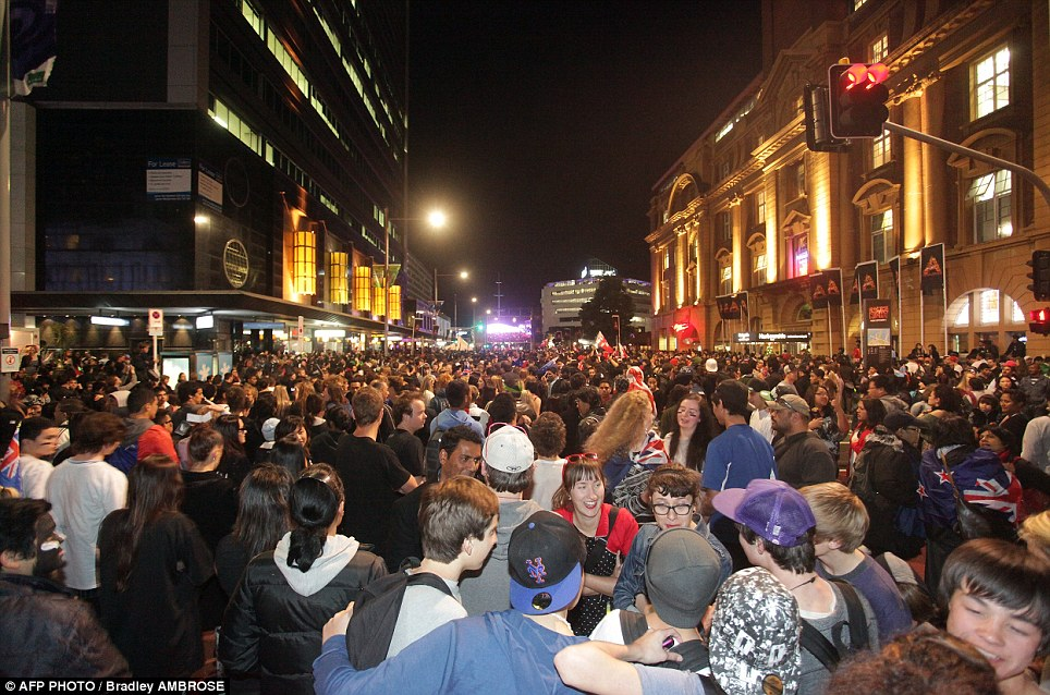 Party atmosphere: Thousands crammed into Auckland's city centre for the opening ceremony in a mass showing of New Zealand national pride