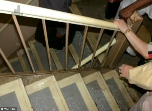 Stepping into hell: Workers in the North Tower are pictured evacuating down Stairwell B