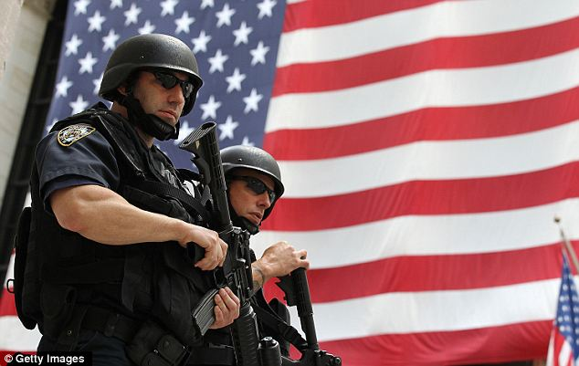 Duty: New York Police Department tactical police officers stand guard near the New York Stock Exchange