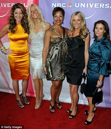Reality on the red carpet: Michaele Salahi, second left, posed with her Real Housewives of D.C. stars last year before her most recent scandal broke