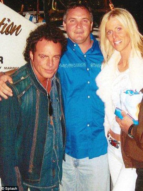From the archives: Journey guitarist Neal Schon (far left) with Tarq and Michaele Salahi in an undated picture. The blonde reality TV star has left her husband for the rocker
