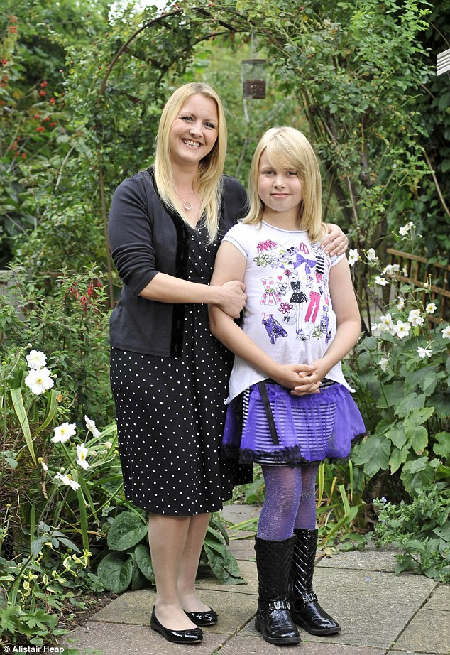 Facing the world: Livvy, who has just returned to Year 6 at school as a girl, stands proudly with her mother Saffron at home in Worcester