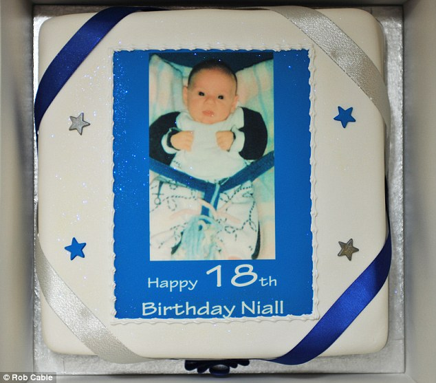 Cute: A picture of Niall as a baby was put on top of the cake with the words Happy 18th Birthday Niall