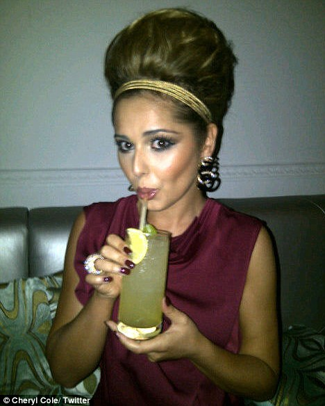 Calming party nerves? Cheryl posted a snap of herself sipping on a cocktail to her Twitter page and captioned it 'It's shoe time.. Haha ;-)'