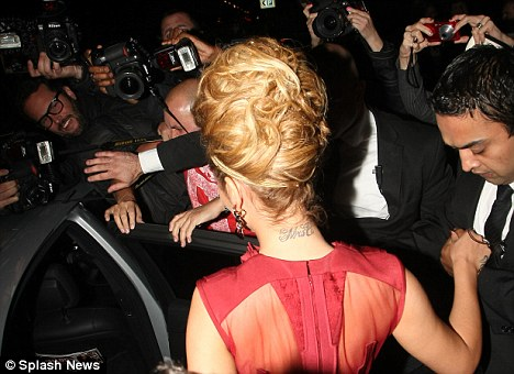 Elaborate: the singer's intricate hair do showed off her 'Mrs C' tattoo, which she has not removed