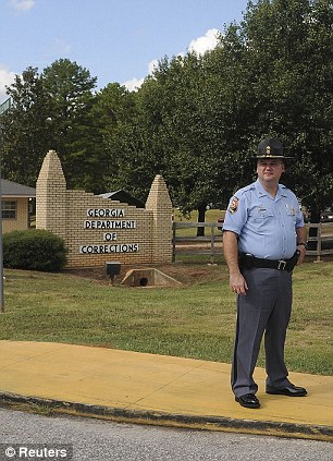 On guard: Georgia State Patrol and other security officers stand in front of the Georgia Diagnostic and Classification prison, where convicted killer Troy Davis was executed by lethal injection