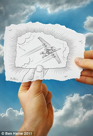 Trick of the eye: Ben Heine's drawing takes optical illusion to a new level as a hand holds a paper aeroplane in this image