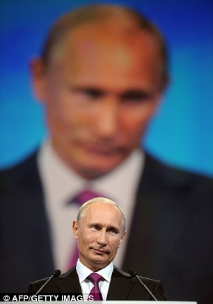 Russia's Prime Minister Vladimir Putin speaks at the congress of Russia's ruling party in Moscow