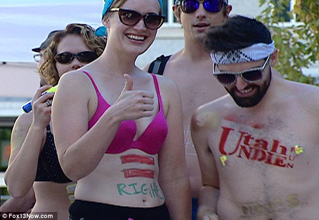 Speaking out: The organisers told runners to paint political messages on their stomachs