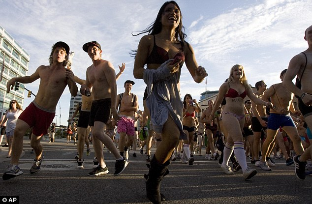Cool runnings: Wearing very little, around 3,000 people took part in the Salt Lake City Utah Undie Run