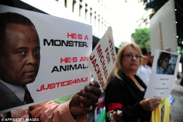 Trial: Supporters at the late pop star Michael Jackson hold signs outside Los Angeles Superior Court