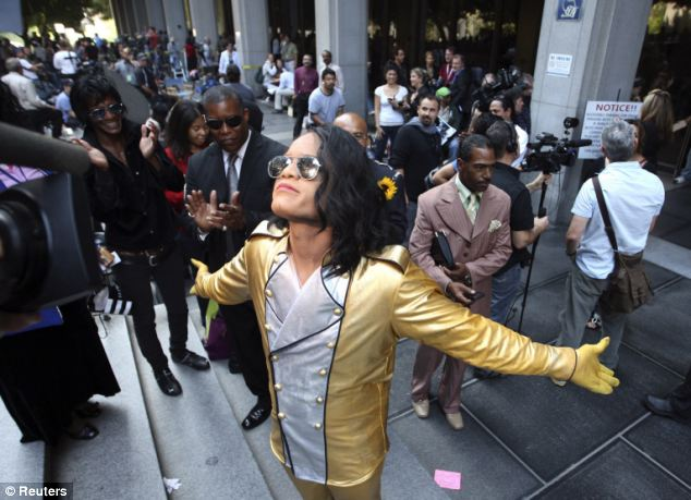 Fans: Michael Jackson impersonator Goward Horton poses for the media outside the courthouse