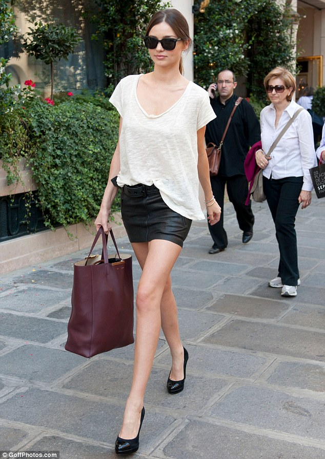 Leggy in leather: Miranda Kerr showed off her long toned legs as she shopped in Paris today