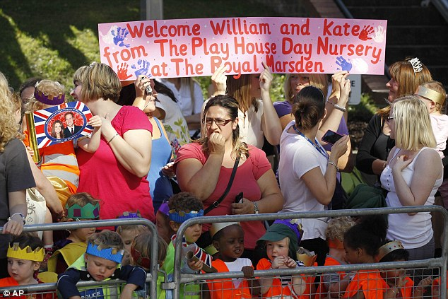 Children and staff wait for the couples' arrival