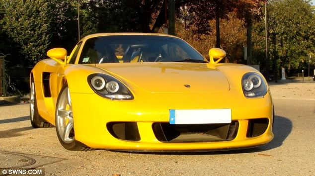 Yellow fever: This Porsche Carrera GT worth a reported £350,000 was one of several cars repossessed