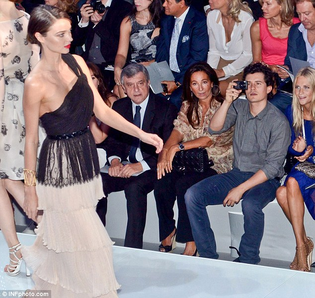 So proud: Orlando Bloom took photographs from the front row