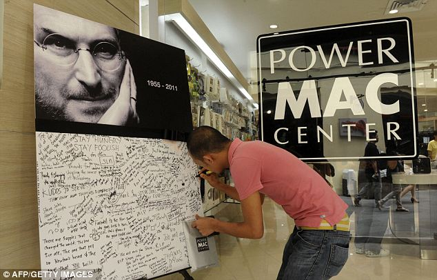 iSad: An admirer writes a message on a board in mourning of the death of Jobs outside an Apple store in Manila