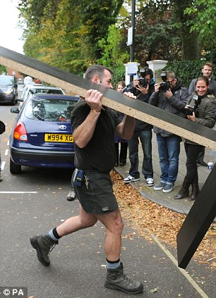 Moving in: Workers deliver temporary furniture to the North London home