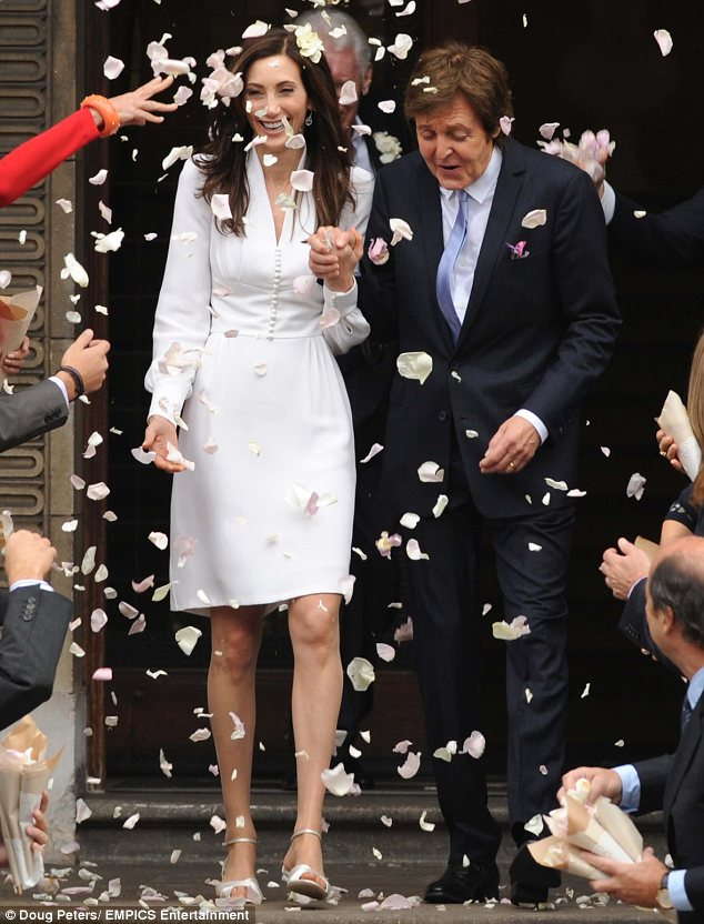 Man and wife: Sir Paul McCartney and his new wife Nancy Shevell wed in an intimate ceremony at Marylebone Town Hall today