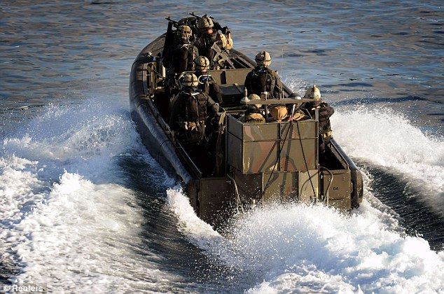 A British Royal Naval boarding team travel by boat during the operation