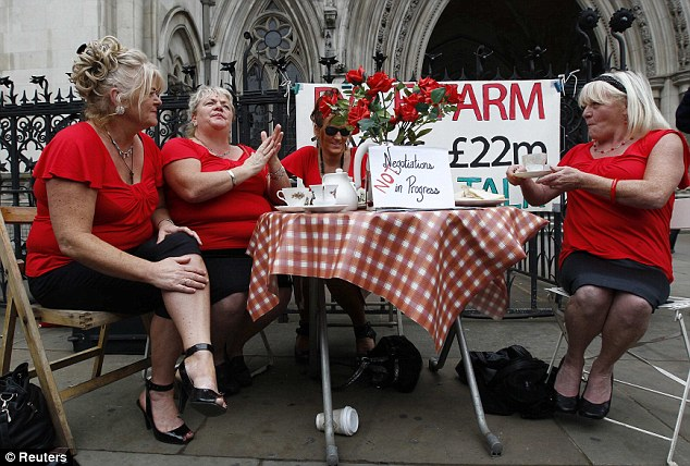 The picnic's over: Dale Farm residents, and sisters, Margaret, Maria, Nora and Kathleen McCarthy sit and drink tea outside the High Court today ahead of the judgment