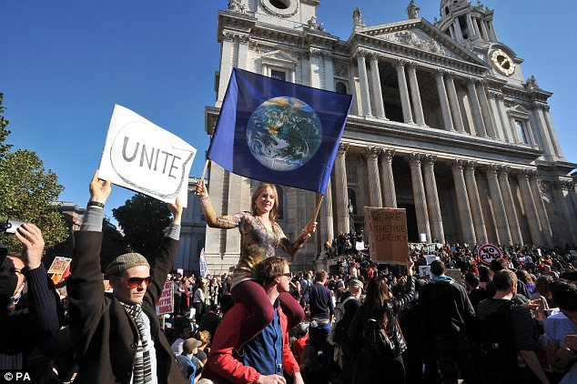 Unite! A woman holds a flag during a protest against the global financial system outside St Paul's Cathedral