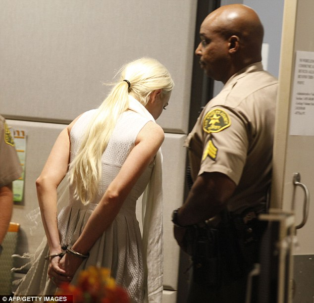Troubled: Lohan and her bail bondsman will now have to deal with the paperwork to get her released from custody