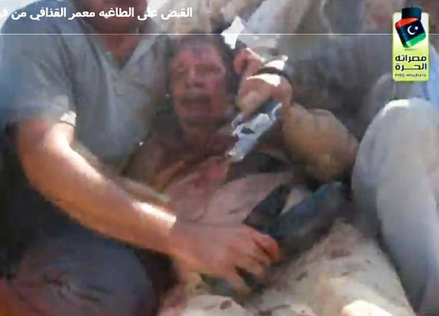 Arguing: Gaddafi pictured minutes before he was killed