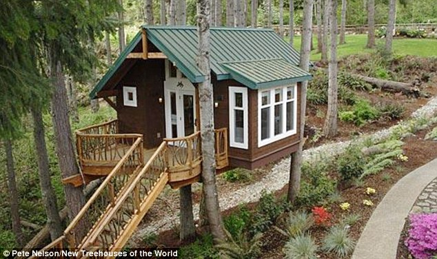 Cute cabin: This Issaquah treehouse has a long staircase which descend to a hot tub deck and zip line platform