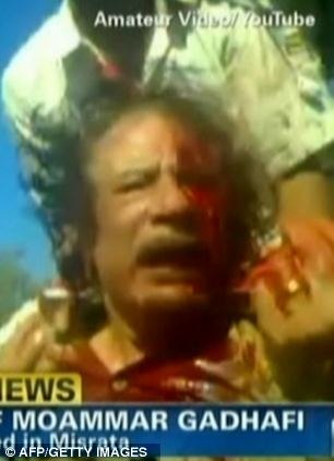 This still image from YouTube courtesy of CNN shows Gaddafi's final moments