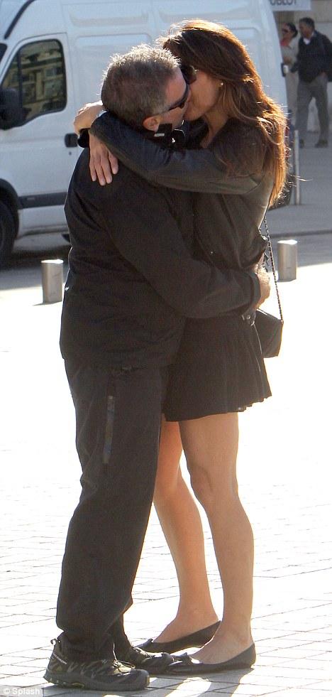 The kisser king: Robin William and Susan Schneider lock lips today during their honeymoon in Paris