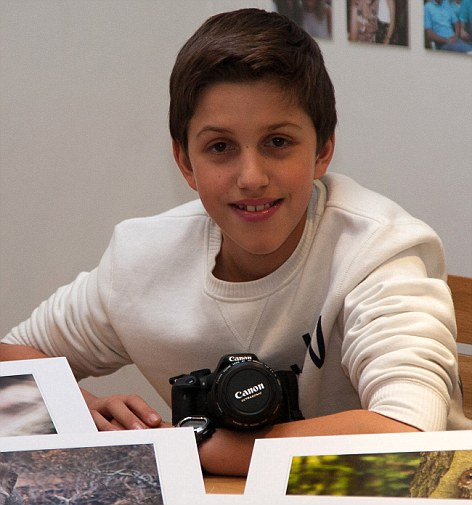 Young master: Sam Kaye began taking photos aged just six and has already won several prestigious awards. He said his dream job would be travelling the world taking nature photos