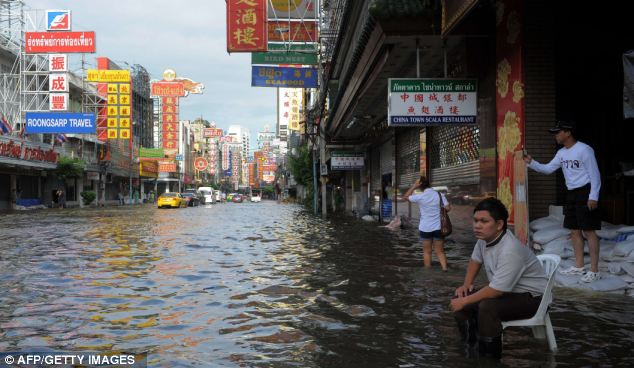 Under water: The Chinatown district of Bangkok. The flooding has sparked an exodus from the capital as waters creep closer to the city centre