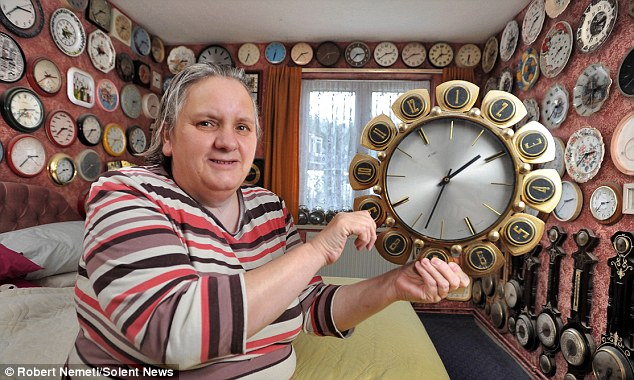 The clock lady: Pauline West has more than 4,000 clocks, she said they make a 'hell of a racket' when they chime