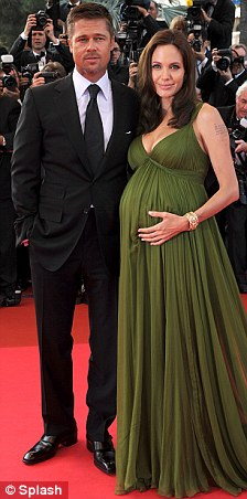 Off Christmas card list: Jennifer and Jarod (left) were inspired by a pregnant Brangelina (right)