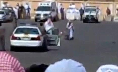 An executioner lines up his sword on the back of the neck of 'sorcerer' Abdul Hamid Bin Hussain Bin Moustafa al-Fakki