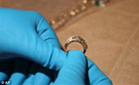 Evidence: This ring, which belonged to Tina Washington, 39, was found in Goudeau's apartment. Ms Washington was shot dead and found in an alleyway in December 2005