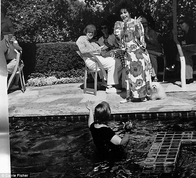 Making waves: Carrie emerges from the water after challenging Elizabeth Taylor to shove her into the pool in 1998
